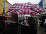 SX15979 Simon and Marieke under umbrella on Portobello Road market, Notting Hill, London.jpg